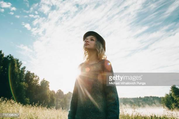 Caucasian woman standing in sunny landscape
