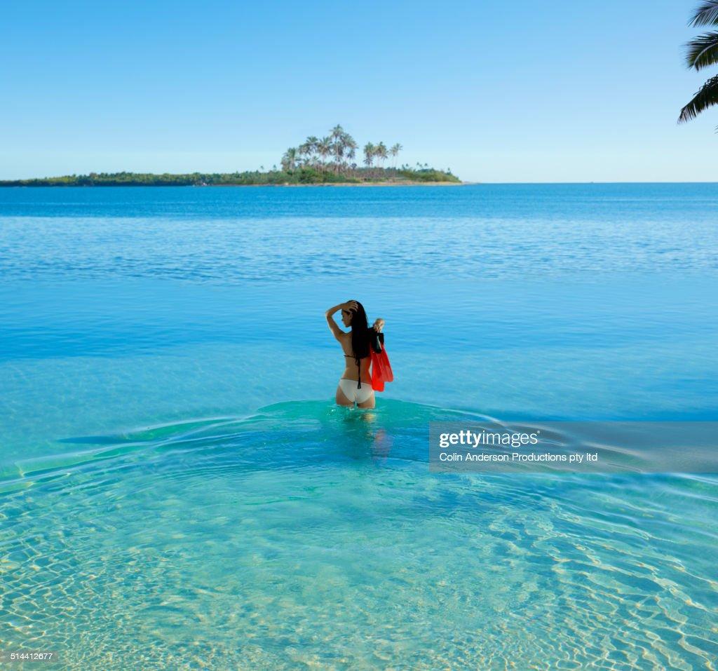Caucasian woman standing in tropical ocean : Stock Photo