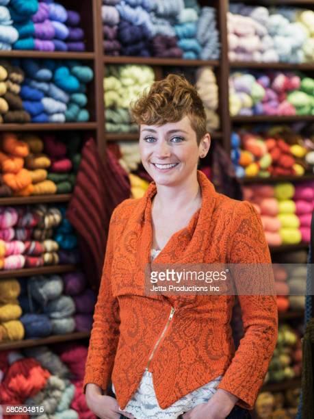 Caucasian woman standing in yarn store