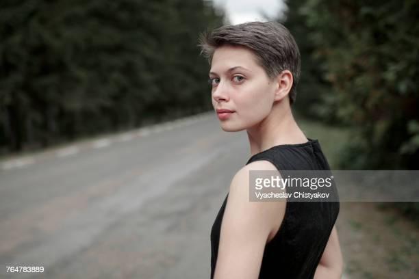 Caucasian woman standing near road