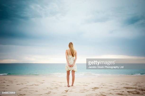 Caucasian woman standing on beach