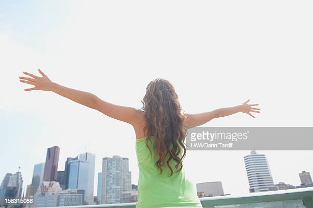 Caucasian woman standing on city balcony