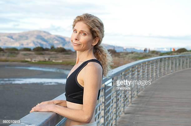 Caucasian woman standing on footbridge