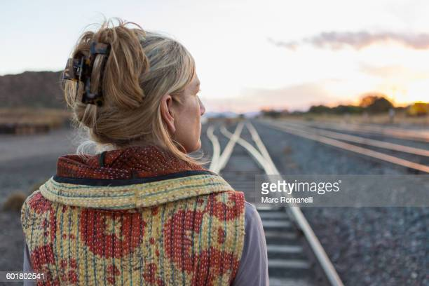 Caucasian woman standing on train tracks