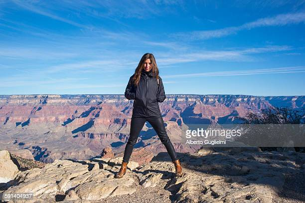 Caucasian woman standing over Grand Canyon, Arizona, United States