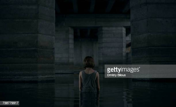 caucasian woman standing waist deep in water - waist deep in water stock pictures, royalty-free photos & images