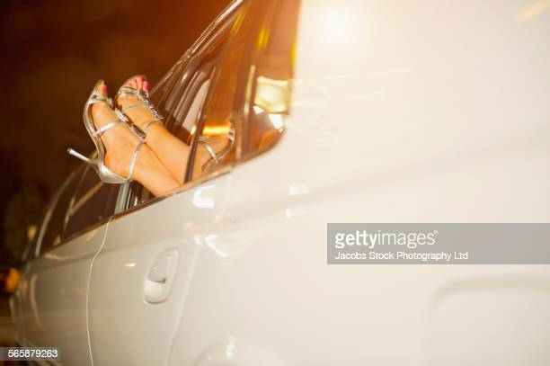 caucasian woman sticking feet out limousine window - celebrity feet stock photos and pictures
