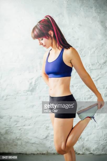 Caucasian woman stretching