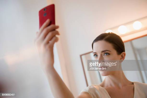 Caucasian woman taking selfie