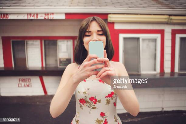 Caucasian woman taking selfie with cell phone