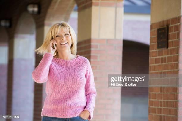 caucasian woman talking on cell phone - caldwell idaho foto e immagini stock