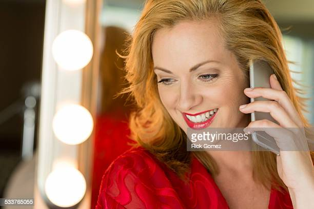 caucasian woman talking on cell phone - risque woman stock photos and pictures
