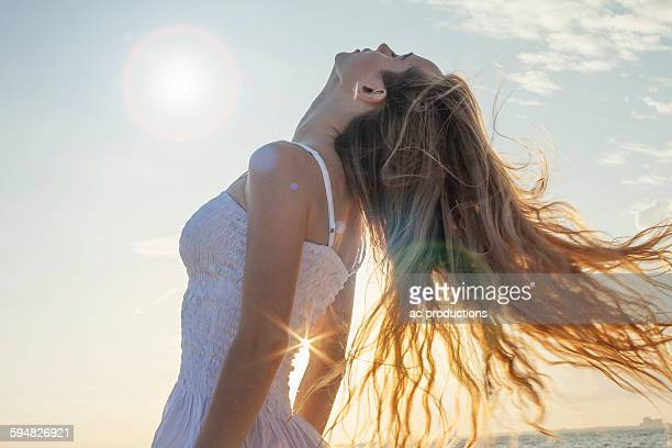 Caucasian woman tossing her hair outdoors