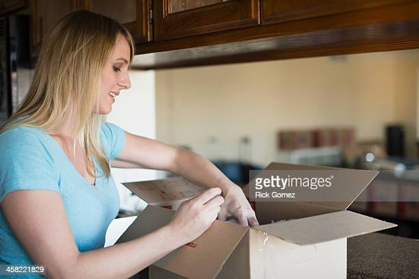 Caucasian woman unpacking in new home