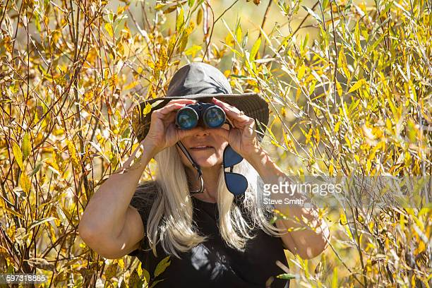 Caucasian woman using binoculars