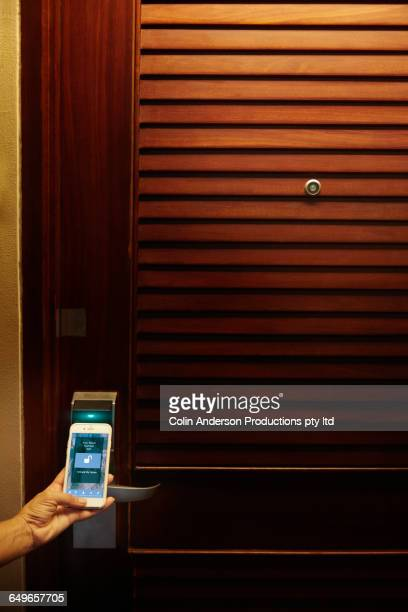 Caucasian woman using cell phone as hotel room key