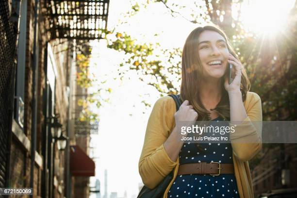 caucasian woman using cell phone in city - 応答する ストックフォトと画像