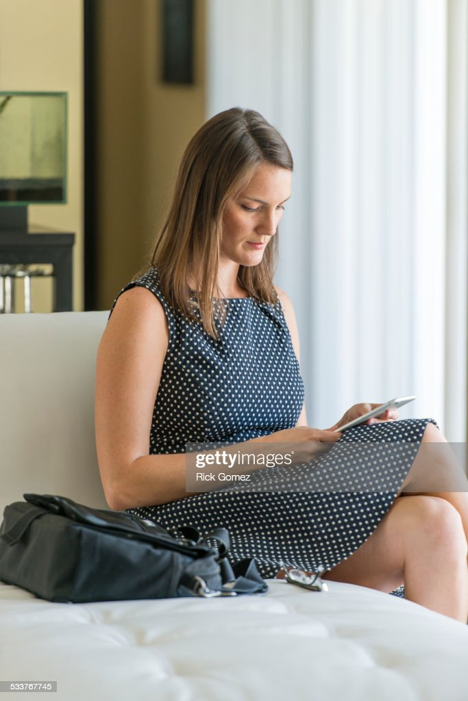 Caucasian woman using cell phone on sofa : Foto stock