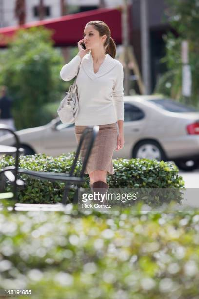 Caucasian woman using, cell phone outdoors