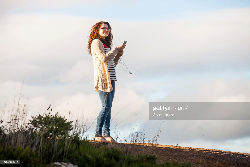 Caucasian woman using cell phone outdoors : Foto stock