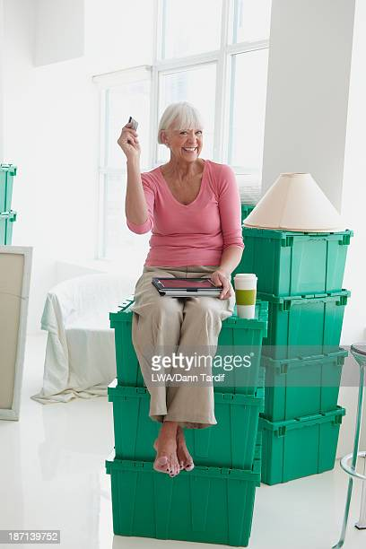 Caucasian woman using digital tablet in new home