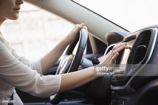 Caucasian woman using GPS system in car