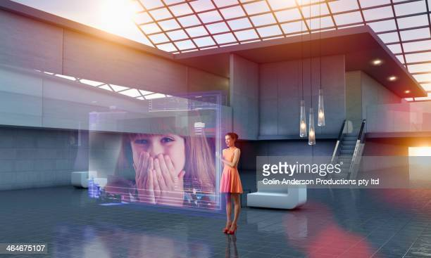 caucasian woman using hologram computer screen - touch sensitive stock pictures, royalty-free photos & images