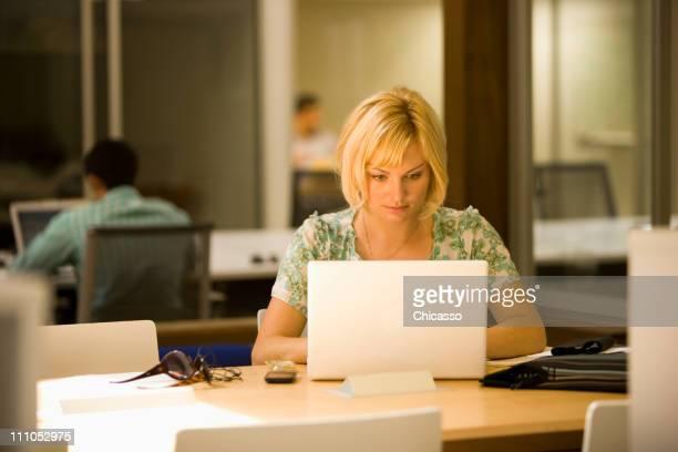 Caucasian woman using laptop in office