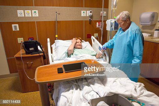 Caucasian Woman Visiting Her Friend Sick In Hospital Bed
