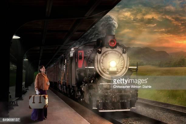 Caucasian woman waiting on train platform
