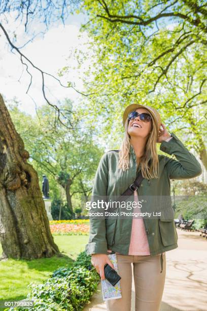 Caucasian woman walking in park