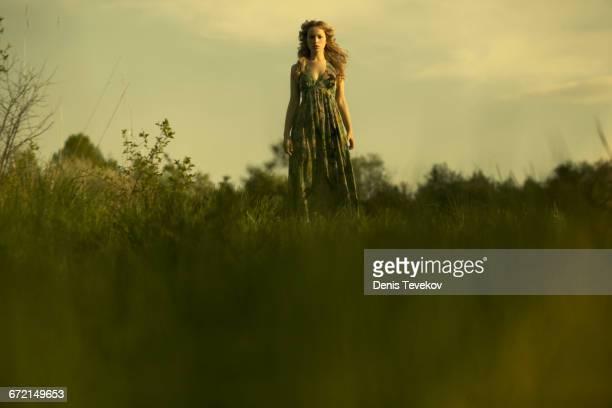 Caucasian woman walking in rural field