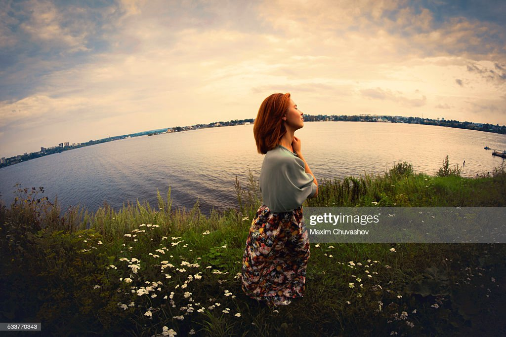 Caucasian woman walking near lake : Foto stock