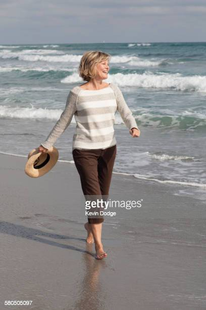 Caucasian woman walking on beach