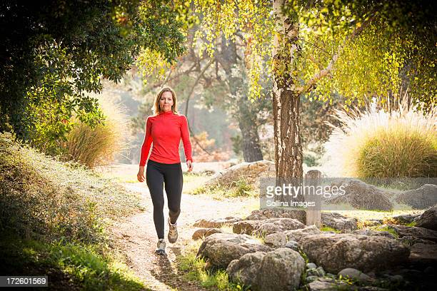 Caucasian woman walking on path