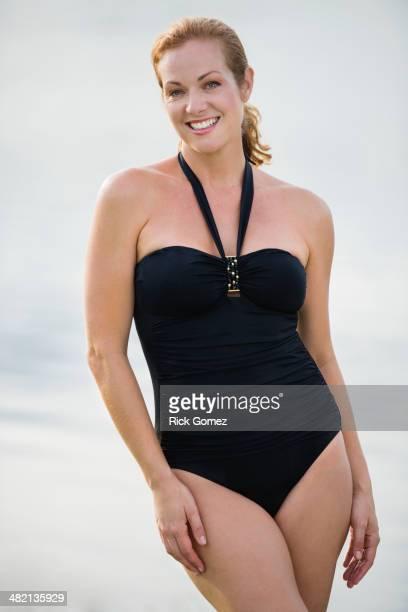 Caucasian woman wearing bathing suit outdoors