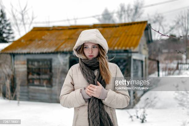 Caucasian woman wearing coat and scarf in winter