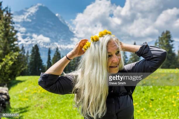 Caucasian woman wearing crown of flowers