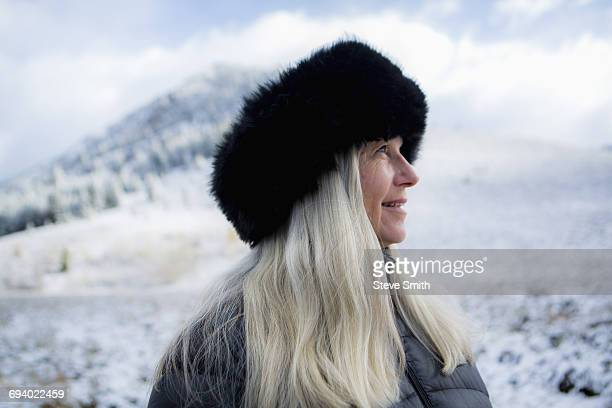 caucasian woman wearing fur hat in winter - fur hat stock photos and pictures