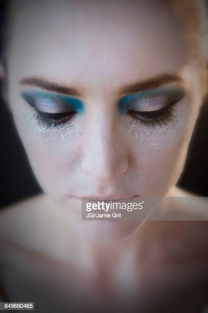 Caucasian woman wearing glamorous makeup