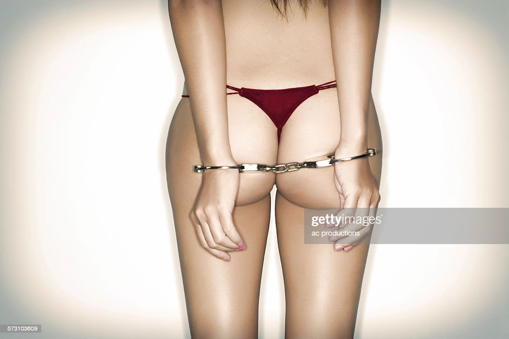 Caucasian woman wearing lingerie and handcuffs : Stock Photo