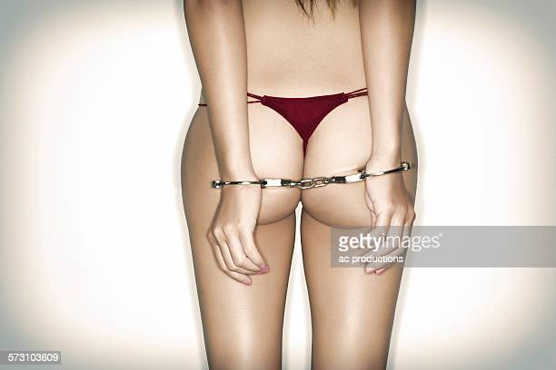 caucasian woman wearing lingerie and handcuffs - sadomasoquismo fotografías e imágenes de stock