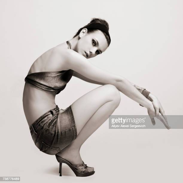 caucasian woman wearing miniskirt and high heels - high heels short skirts stock pictures, royalty-free photos & images