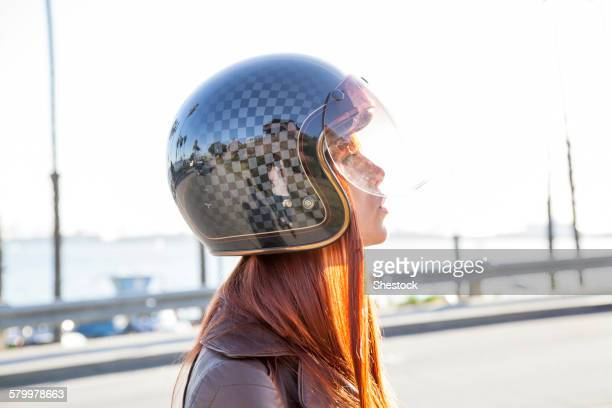 caucasian woman wearing motorcycle helmet - crash helmet stock pictures, royalty-free photos & images