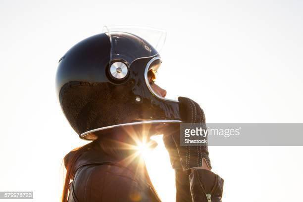 caucasian woman wearing motorcycle helmet - sports helmet stock pictures, royalty-free photos & images
