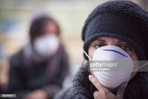 Caucasian woman wearing protective breathing mask