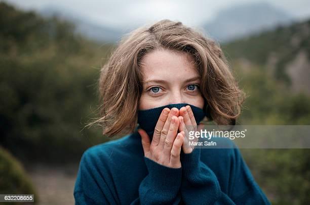 caucasian woman wearing turtleneck sweater outdoors - turtleneck stock pictures, royalty-free photos & images
