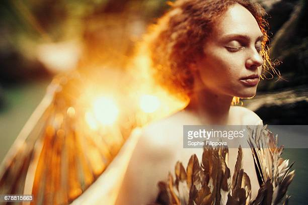 Caucasian woman with angel wings