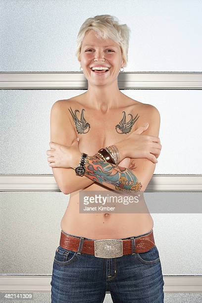 caucasian woman with bare chest showing off tattoos - chest barechested bare chested stock-fotos und bilder