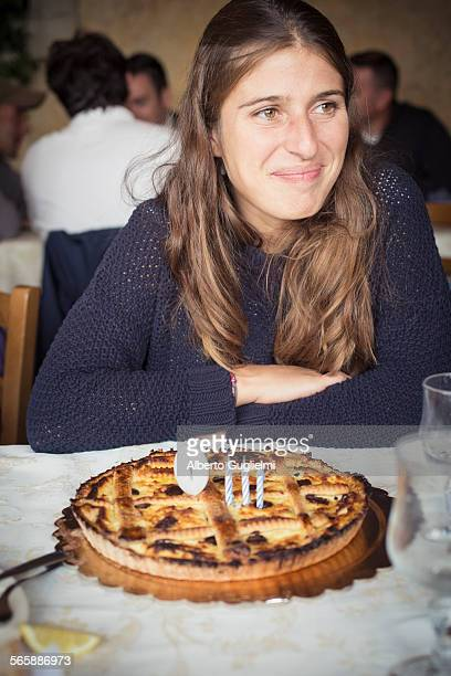 Caucasian woman with birthday cake in restaurant